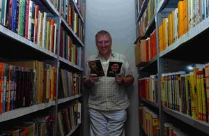 Curator Peter Riley with some of John Creasey's books in the stores at Salisbury Library. DB4762P2