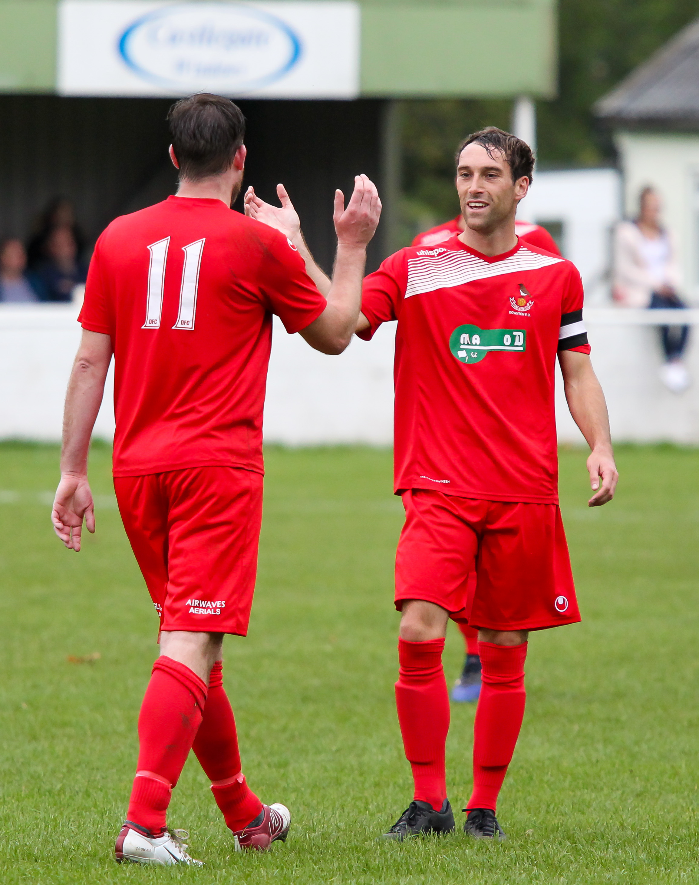 Craig Tyson congratulates Paul Gulliver on his goal during the Whichurch game. Picture by Dave Cavanagh