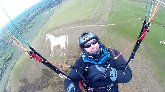 Paraglider spiralled to his death after flying into