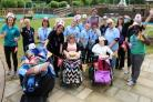 Staff and children at Naomi House & Jacksplace hospices celebrating funding success