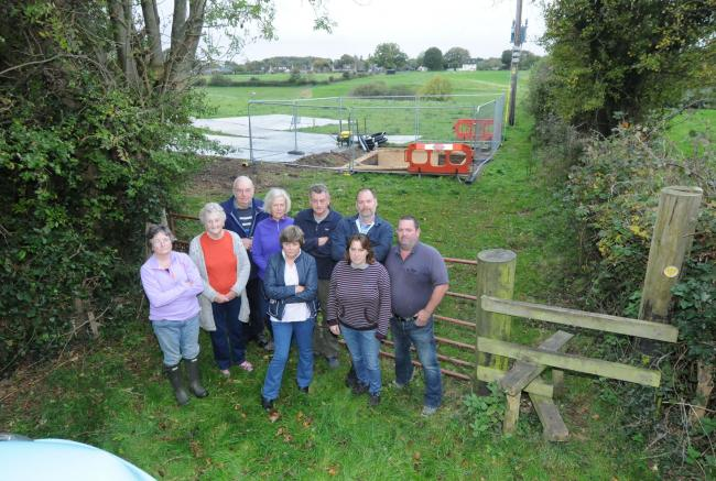 Woodfalls residents pictured when work started on a mobile phone mast despite plans being refused