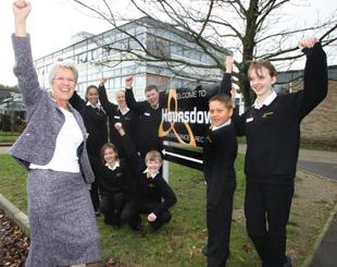 TOP OF THE CLASS! Pupils from Hounsdown School celebrate their excellent Ofsted results with head teacher Di Nightingale.