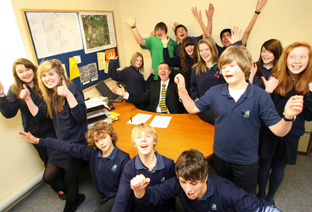 CELEBRATING: Head teacher Chris Willsher and pupils of Priestlands School after the school's 'outstanding' Ofsted report.