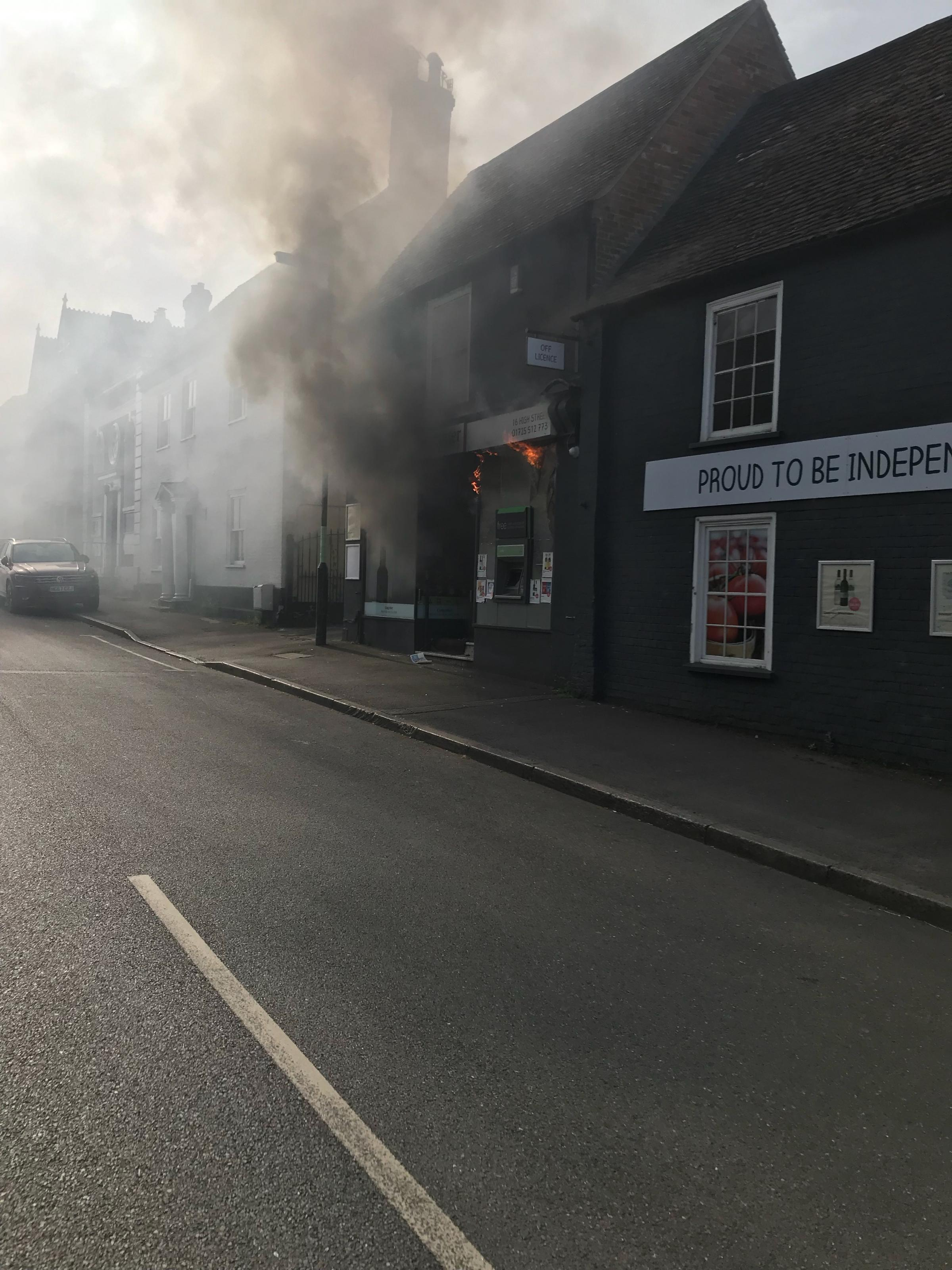 Smoke and flames coming from Costcutter in Downton  Picture by Colin O'Keefe