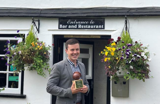 Chris Chester-Sterne, of The Rose and Thistle in Rockbourne, with his Acorn award