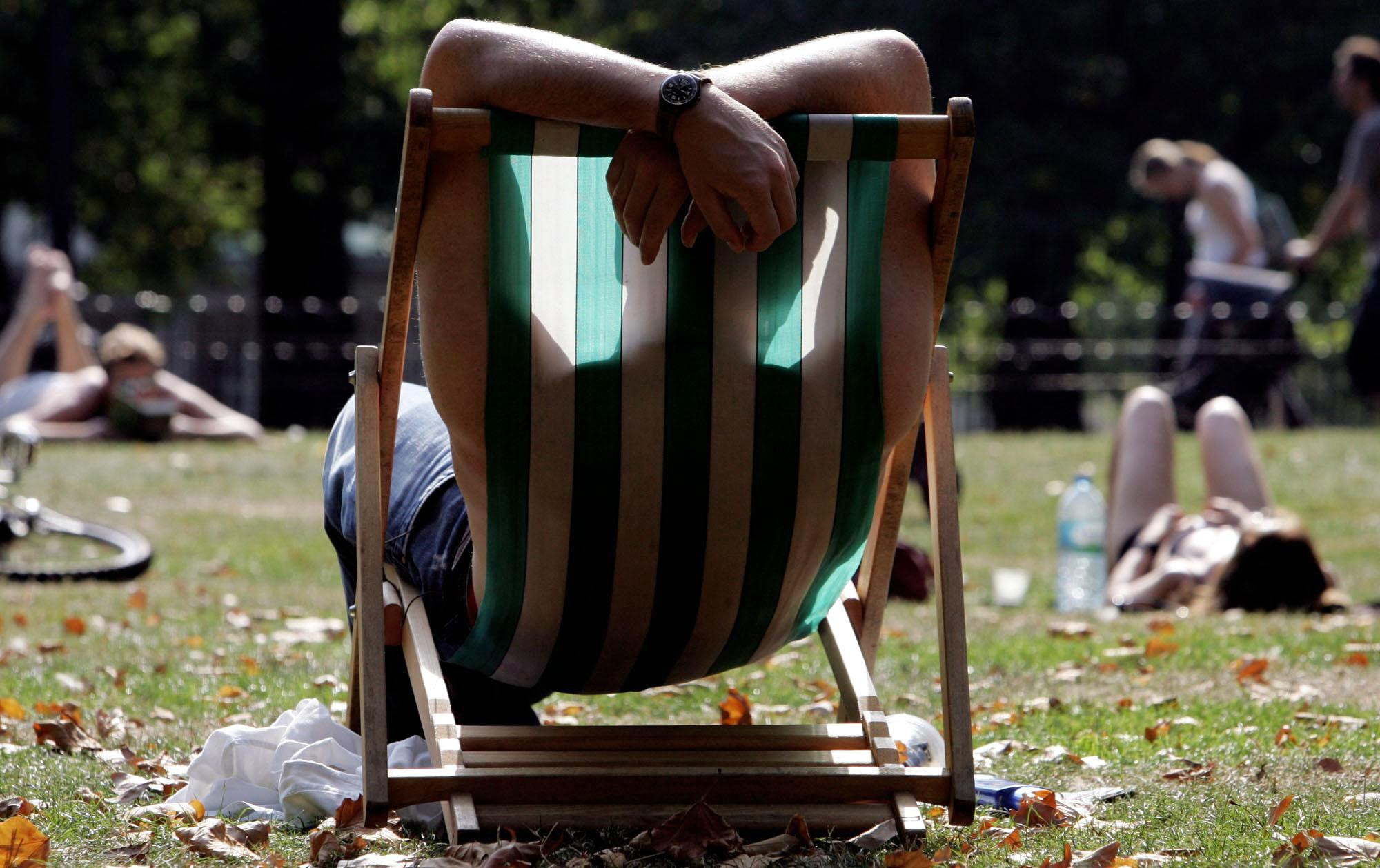 Members of the public sunbathe in London's Green Park, Sunday September 4, 2005, as the capital enjoys the September sunshine. PRESS ASSOCIATION Photo. Photo credit should read: Jane Mingay/PA.