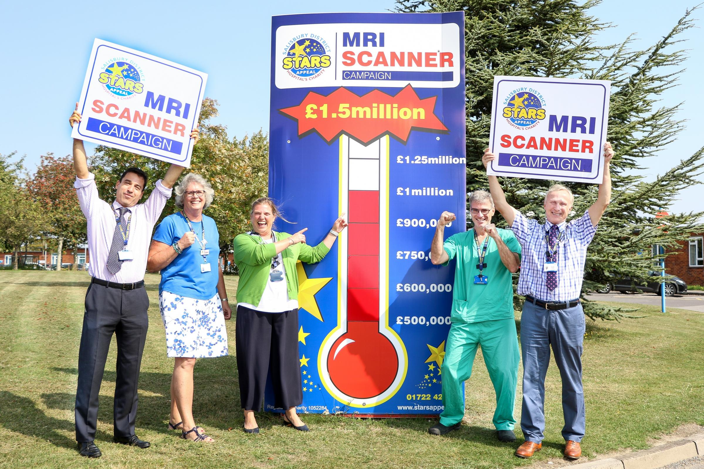 Salisbury District Hospital staff celebrate reaching the £1million mark towards a new MRI scannerPicture by Spencer Mulholland