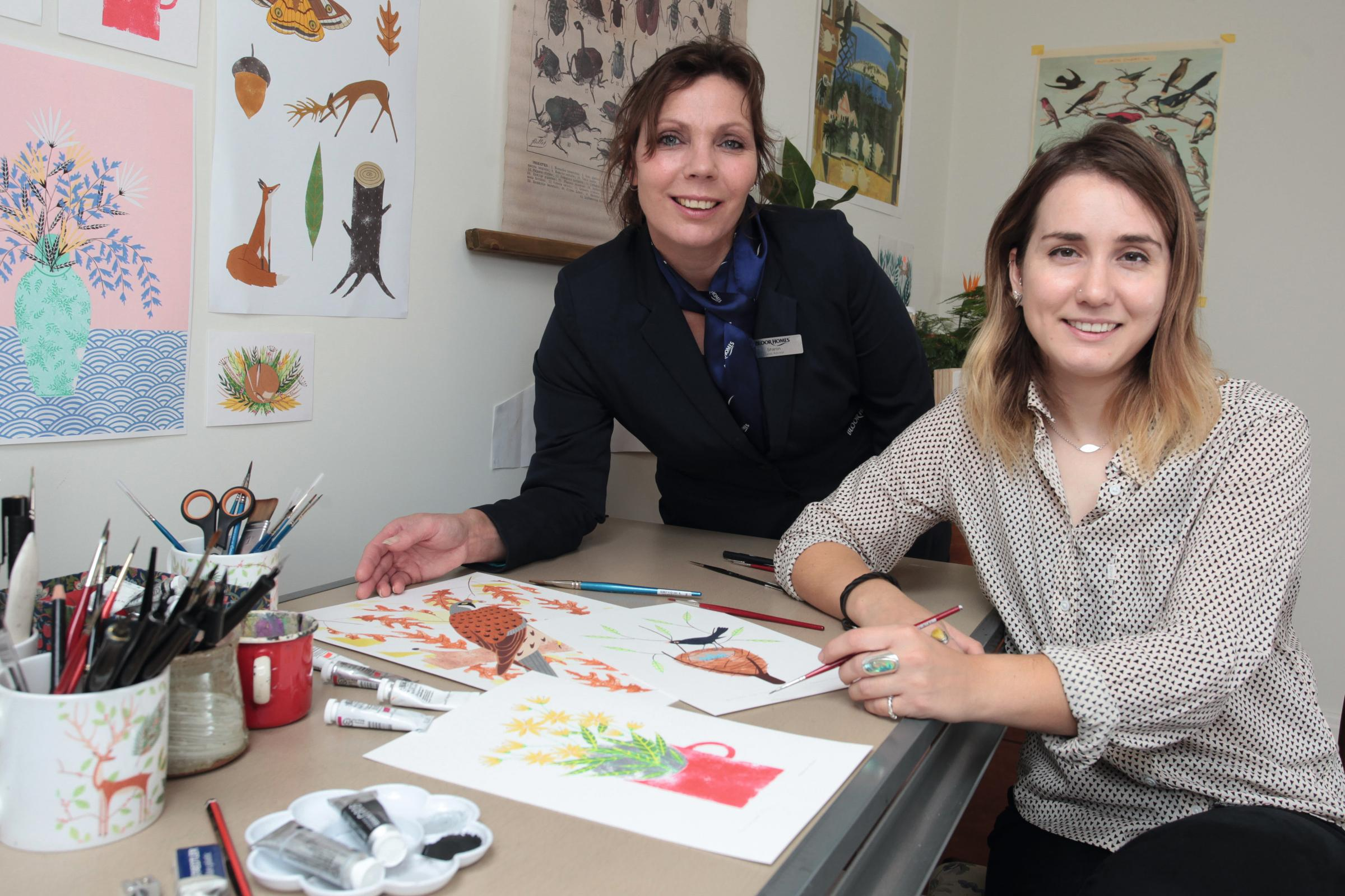 •	Francesca McLean, right, one of six artists to be awarded a bursary for the Frames of Reference art programme, in her studio with Bloor Homes sales advisor Sharon Clarke.