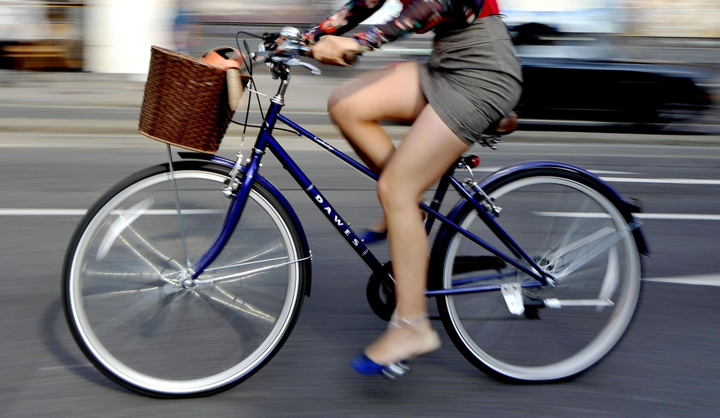 File photo dated 07/08/13 of a woman riding a bike as cyclists are considered to be more intelligent and charitable than the average person, according to a new report. PRESS ASSOCIATION Photo. Issue date: Friday January 10, 2014. A study for the British H