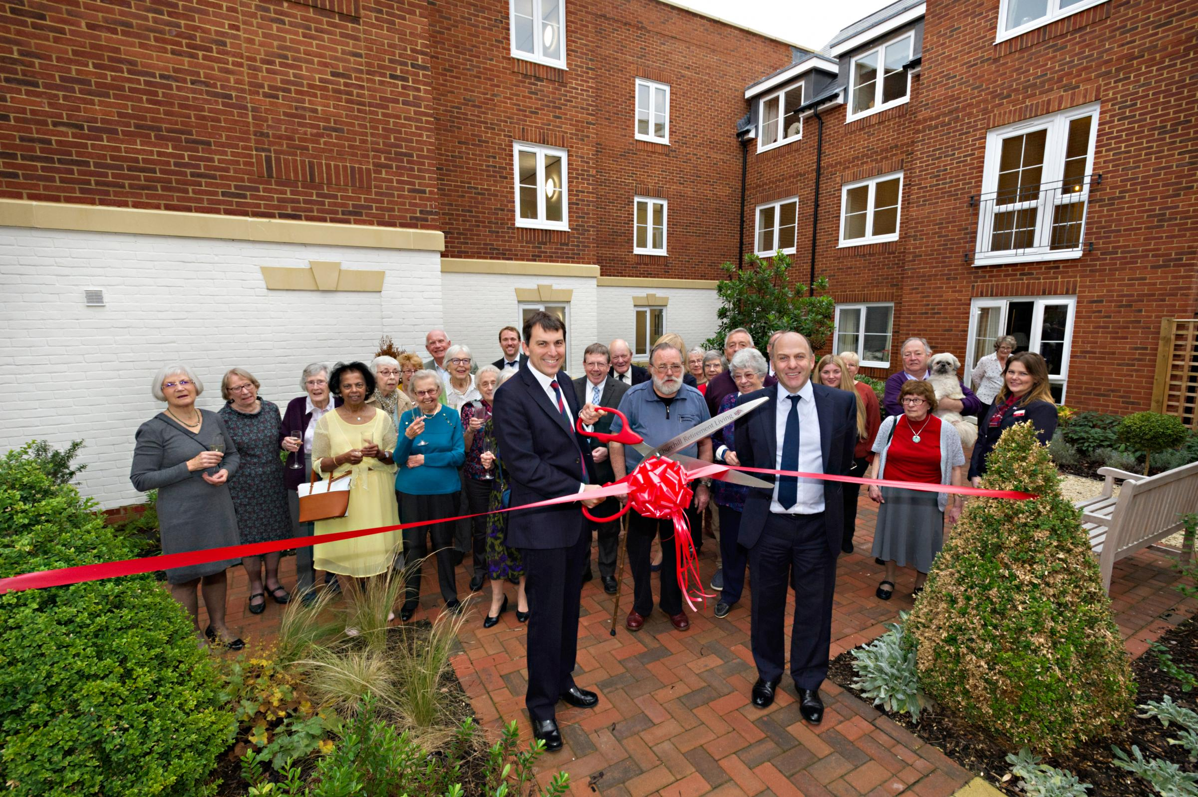 MP John Glen cuts the ribbon at the opening of Sarum Lodge in Salisbury