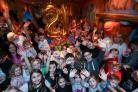 100 children sing happy birthday at Clown About's 21st birthday party                                    Photos by Spencer Mulholland