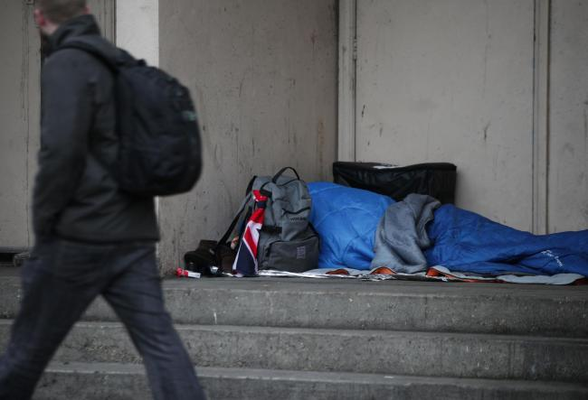 File photo dated 07/02/17 of a person sleeping rough in a doorway. Deaths of rough sleepers and those in emergency accommodation rose from 482 in 2013 to 597 last year across England and Wales, according to the first Office for National Statistics (ONS) r
