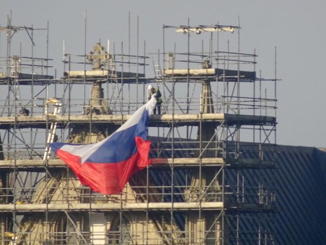 Cathedral staff remove a Russian flag from its scaffolding. Picture from Carol Byrne