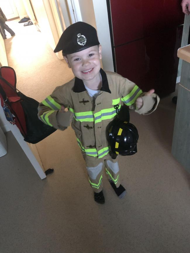 My little man dress as a fireman whilst stealing his dads beret