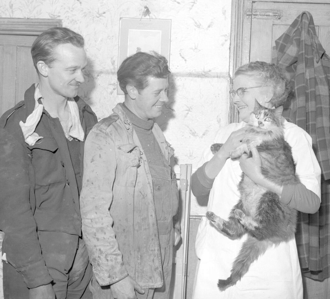 Mr Hook and Mr Moody with Bonnie the cat and her owner Mable Bugden