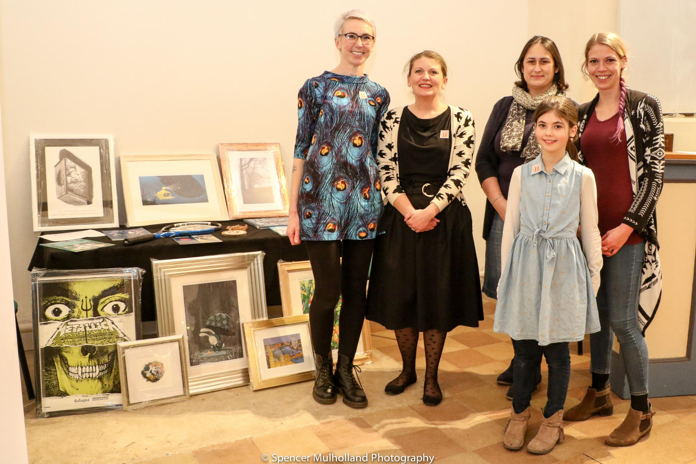 Auction organisers at the secret postcard sale from Pembroke Park School, PTFA Treasurer Stacey Kiely, PTFA Chair Kate Pelopida, Head Yasmine Johnston, PTFA Secretary Mae Lynn and postcard artist 10-year-old Megan at Salisbury Museum