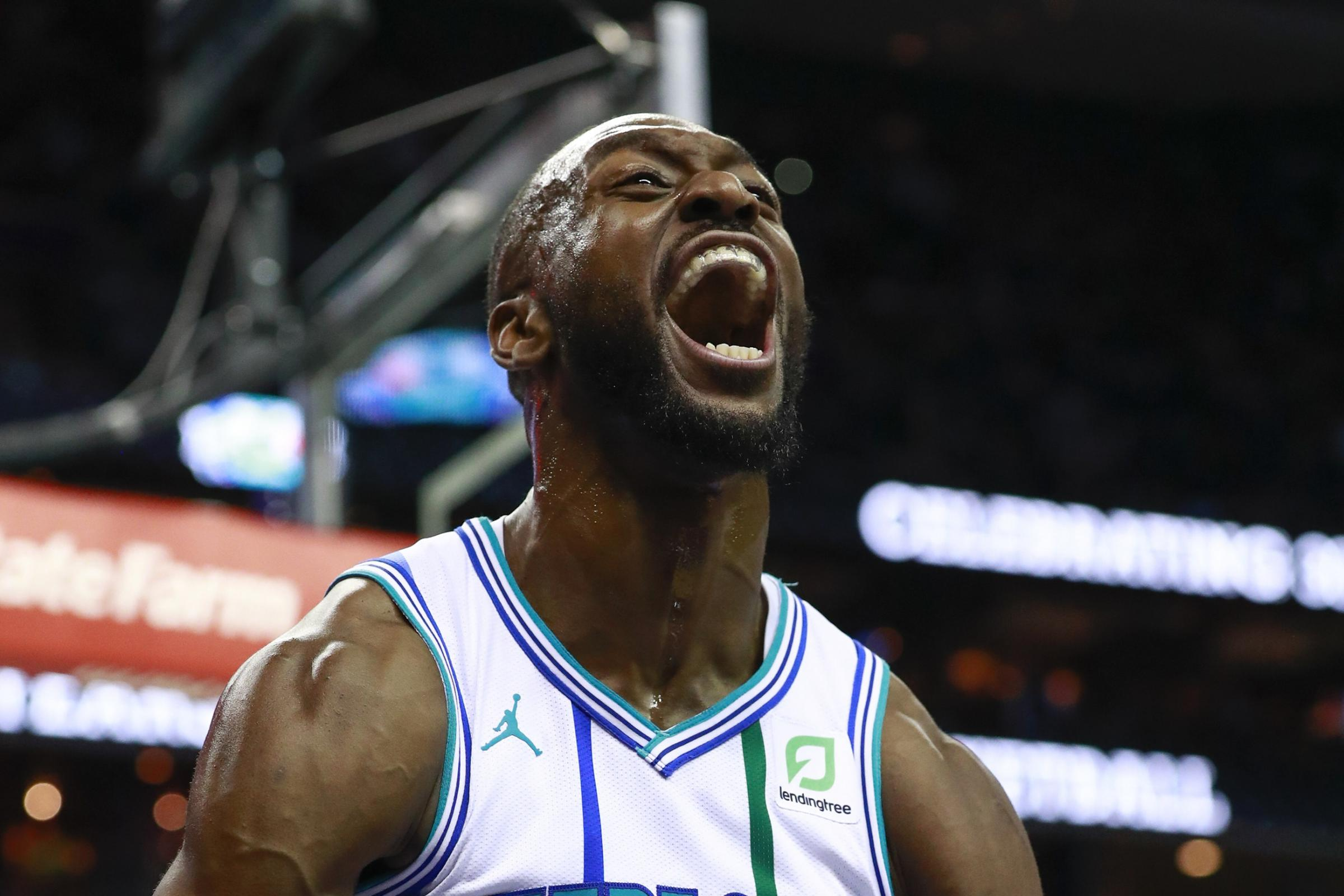 Charlotte Hornets guard Kemba Walker reacts after scoring against the Celtics