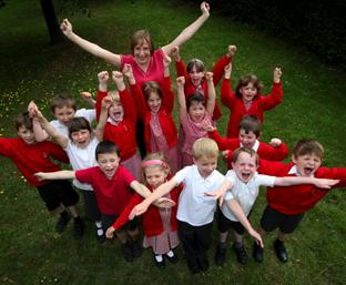 WELL DONE: Foxhills Infant School head Jane Barrett pictured with her pupils celebrating the school's Ofsted report. 	Echo picture by Stuart Martin. Order no: 8858000