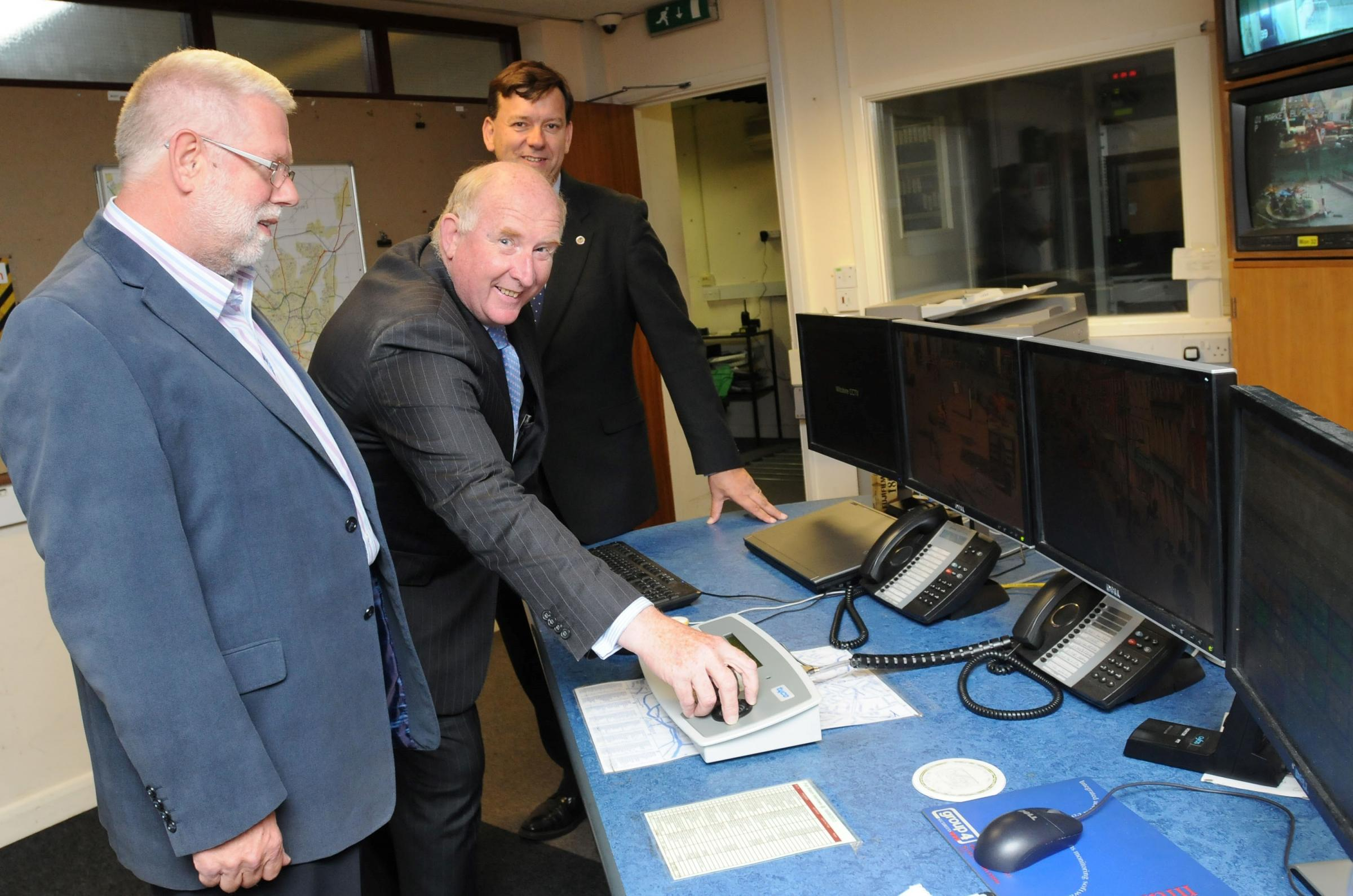 Business manager at Salisbury BID Steve Godwin, police and crime commissioner Angus Macpherson and mayor of Salisbury Andrew Roberts in the CCTV control room in Pennyfarthing House, Salisbury. DC6613P4..Picture by Tom Gregory.