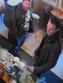 CCTV image of two men police would like to speak to after a serious assault in West Moors.