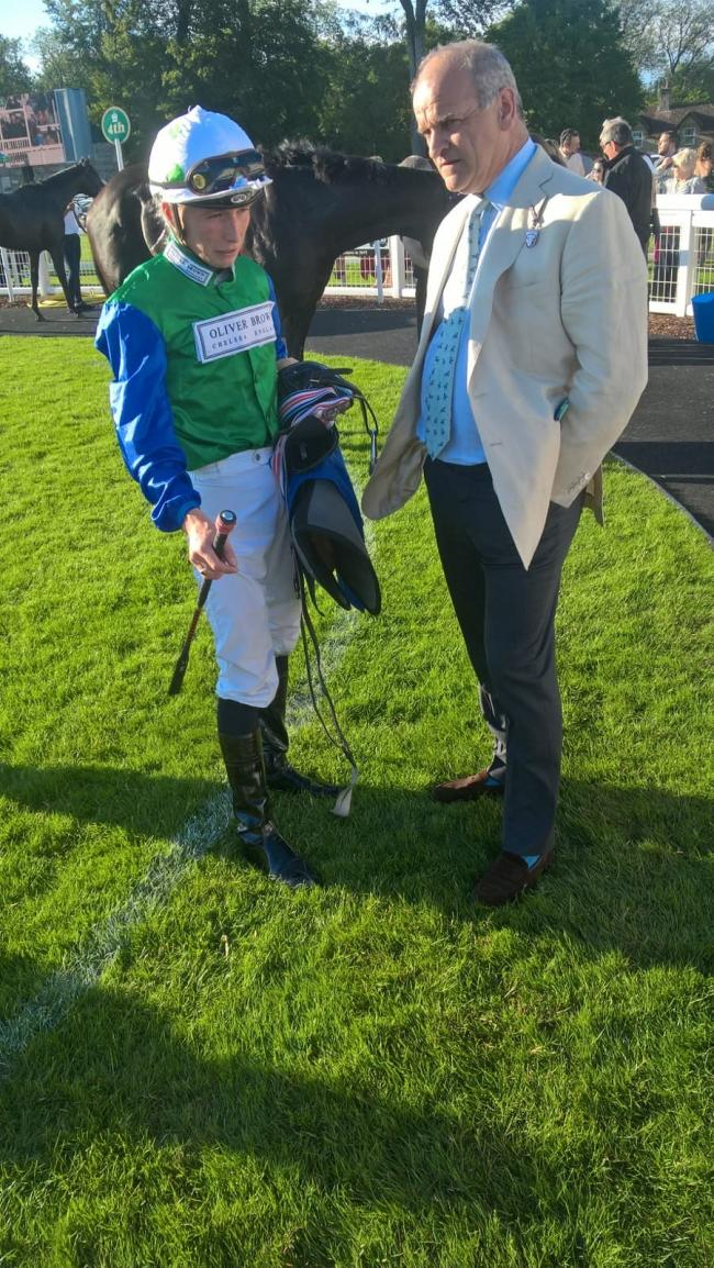 Jason Watson briefs trainer Brian Meehan after Amplify's success at Salisbury