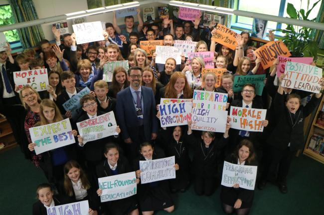 Burgate staff, students and headteacher David Pover (centre) celebrate 'Good' Ofsted report