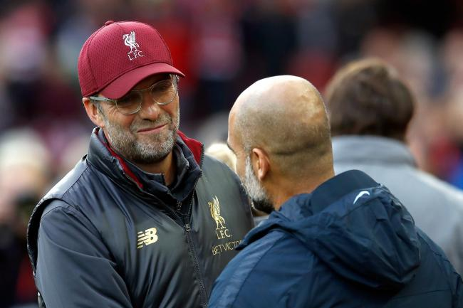Liverpool manager Jurgen Klopp, left and Manchester City's Pep Guardiola